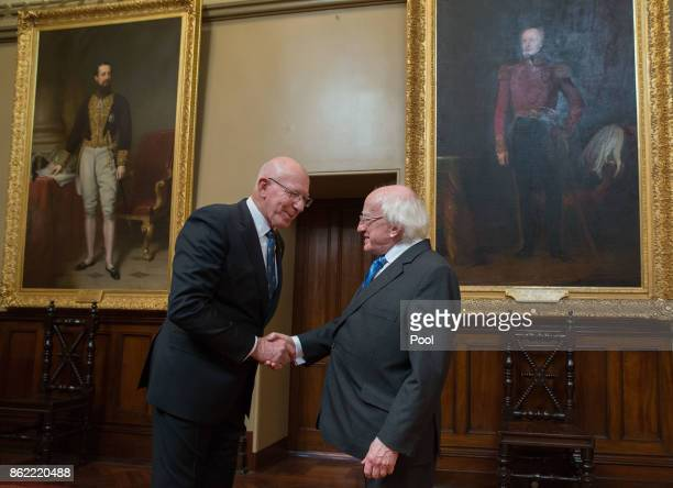 Irish President Michael Higgins shakes hands with New South Wales state Governor David Hurley at Government House on October 17 2017 in Sydney...