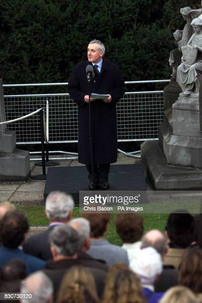 Irish Prime Minister Bertie Ahern delivering the graveside oration in Dublin's Glasnevin cemetery at the reburial of nine of the ten men executed...