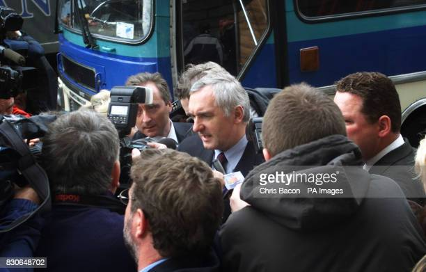 Irish Prime Minister Bertie Ahern is asurrounded by journalists as he arrives at the Dublin Circuit Court after leaving the Northern Ireland peace...