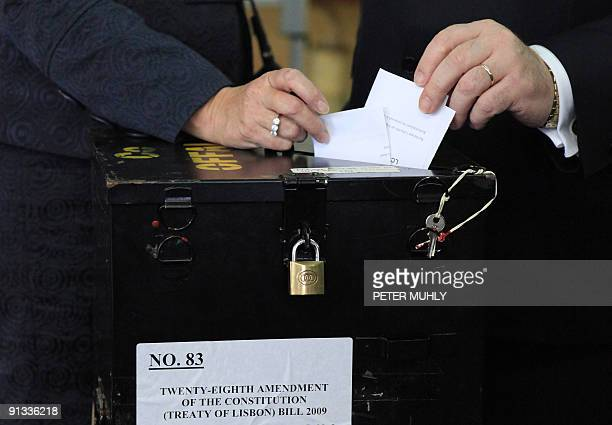 Irish Prime Minister Brian Cowen and his wife Mary Cowen cast their ballot on the second referendum on the European Union's Lisbon Treaty in Mucklagh...