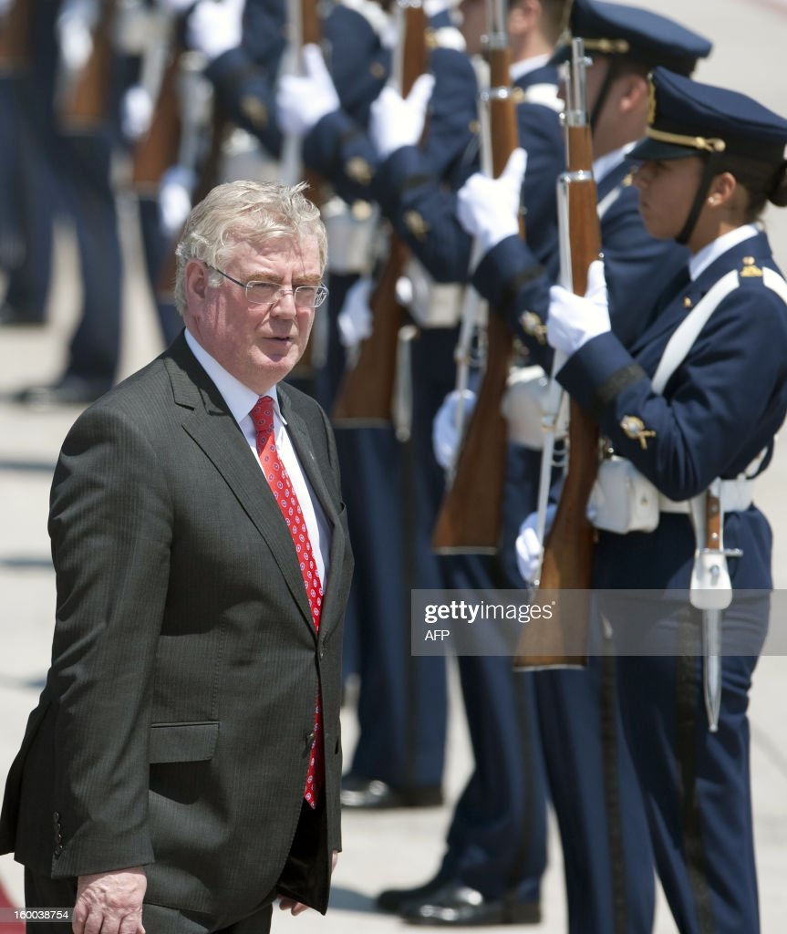 Irish Prime Minister Eamon Gilmore receives military honour upon his arrival at the international airport in Santiago on January 25,2013. More than 40 Heads of State and Government of the Community of Latin American and Caribbean States (CELAC) and the European Union (EU) will meet on January 26 and 27 to promote a strategic partnership between the two regions AFP PHOTO /Claudio SANTANA