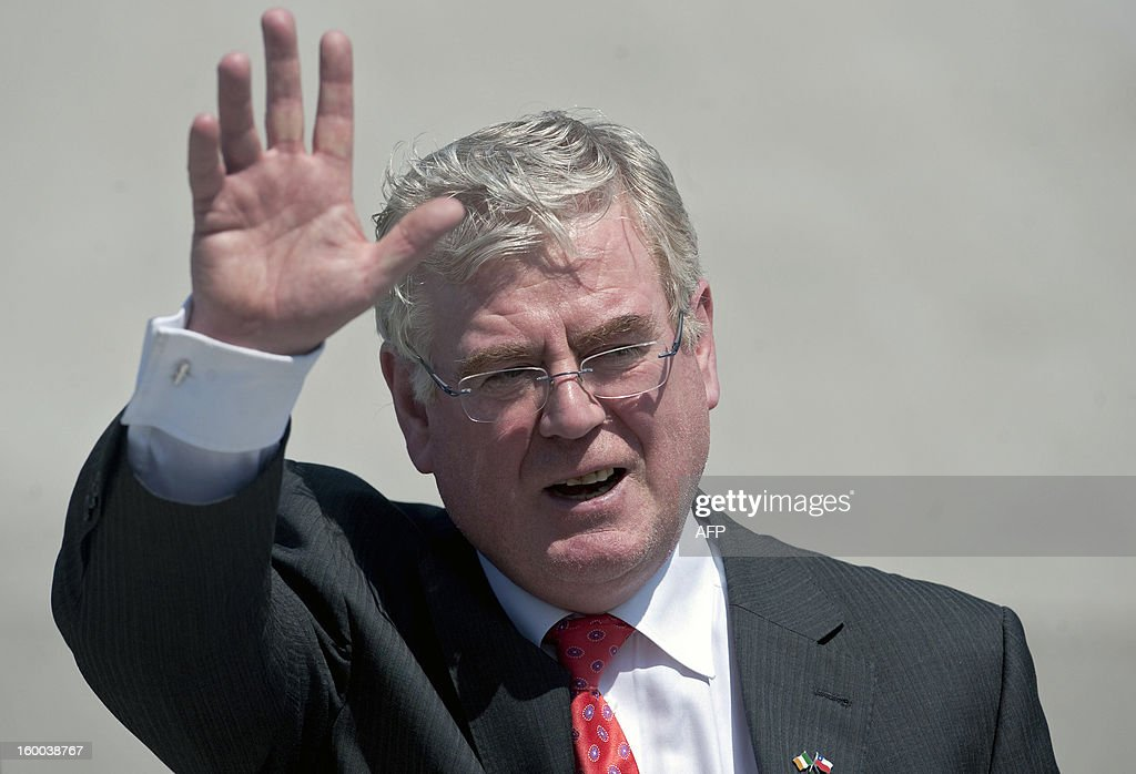 Irish Prime Minister Eamon Gilmore waves upon his arrival at the international airport in Santiago on January 25,2013. More than 40 Heads of State and Government of the Community of Latin American and Caribbean States (CELAC) and the European Union (EU) will meet on January 26 and 27 to promote a strategic partnership between the two regions AFP PHOTO /Claudio SANTANA