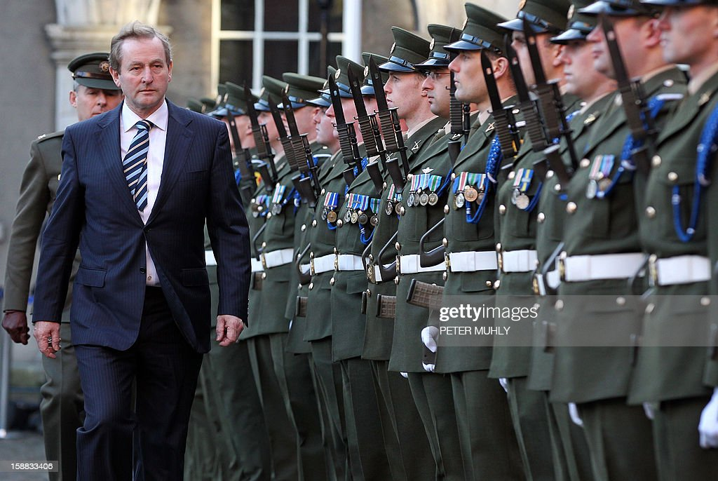 Irish Prime Minister Enda Kenndy inspects the Irish Guard of Honour during a flag-raising ceremony at Dublin Castle in Dublin, Ireland on December 31, 2012 ahead of Ireland's assumption of the rotating presidency of the European Union on Jauary 1, 2013.