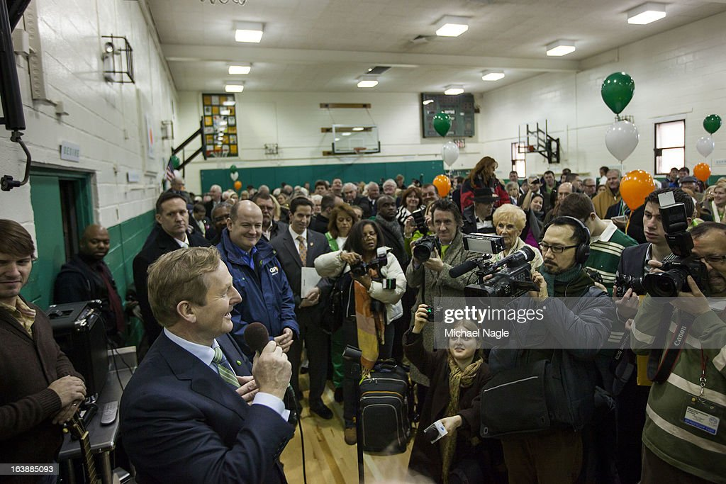 Irish Prime Minister Enda Kenny addresses parishioners of St Thomas More Church on Saint Patrick's Day, March 17, 2013 in the Breezy Point neighborhood in the Queens borough of New York City. Breezy Point, home to many residents with Irish ancestry, was devastated by Superstorm Sandy in October 2012.