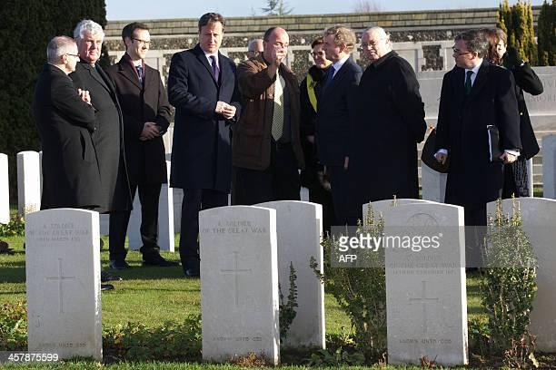 Irish Prime Minister Enda Kenny and British Prime Minister David Cameron visit the Tyne Cot War Graves Cemetery in Passendale on December 19 where...