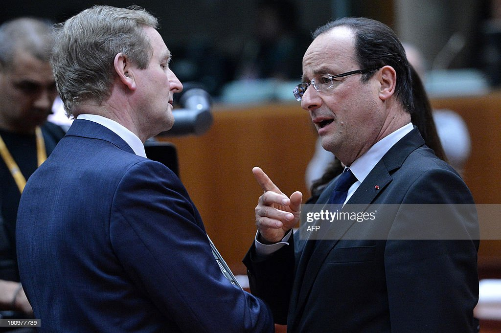 Irish Prime Minister Enda Kenny and French President Francois Hollande chat during a roundtable meeting at the EU Headquarters on February 7, 2013 in Brussels, on the first day of a two-day European Union leaders summit. European Union leaders head into a fresh clash over the EU's budget with the only certainty being that proposals for several years will be cut back.