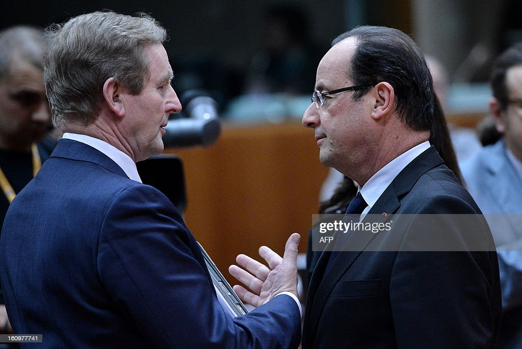 Irish Prime Minister Enda Kenny and French President Francois Hollande chat during a roundtable meeting at the EU Headquarters on February 7, 2013 in Brussels, on the first day of a two-day European Union leaders summit. European Union leaders head into a fresh clash over the EU's budget with the only certainty being that proposals for several years will be cut back. AFP PHOTO / BERTRAND LANGLOIS