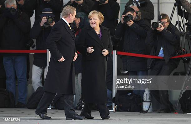 Irish Prime Minister Enda Kenny and German Chancellor Angela Merkel chat upon Kenny's arrival at the Chancellery on November 16 2011 in Berlin...