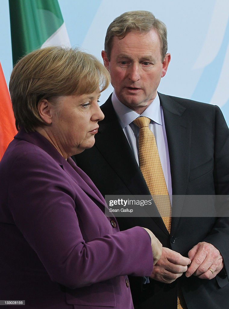 Irish Prime Minister Enda Kenny and German Chancellor Angela Merkel prepare to depart after speaking to the media following talks at the Chancellery...