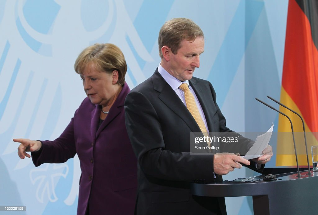 Irish Prime Minister Enda Kenny and German Chancellor Angela Merkel depart after speaking to the media following talks at the Chancellery on November...