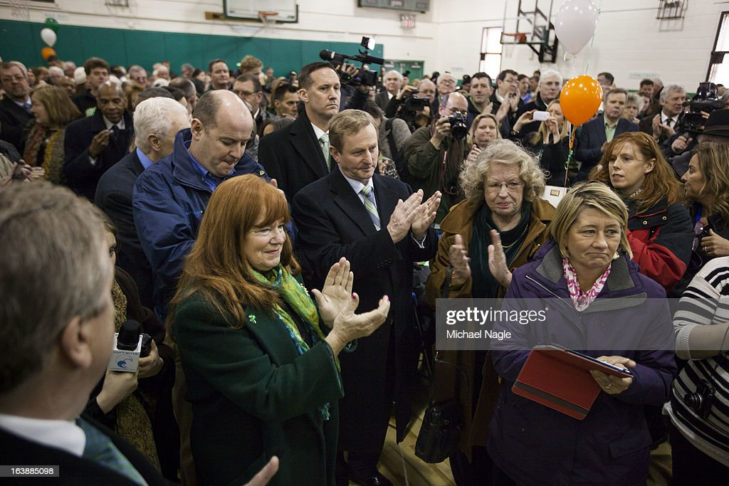 Irish Prime Minister Enda Kenny and parishioners of St Thomas More Church applaud after a performance of the Irish national anthem during Saint Patrick's Day on March 17, 2013 in the Breezy Point neighborhood in the Queens borough of New York City. Breezy Point, home to many residents with Irish ancestry, was devastated by Superstorm Sandy in October 2012.