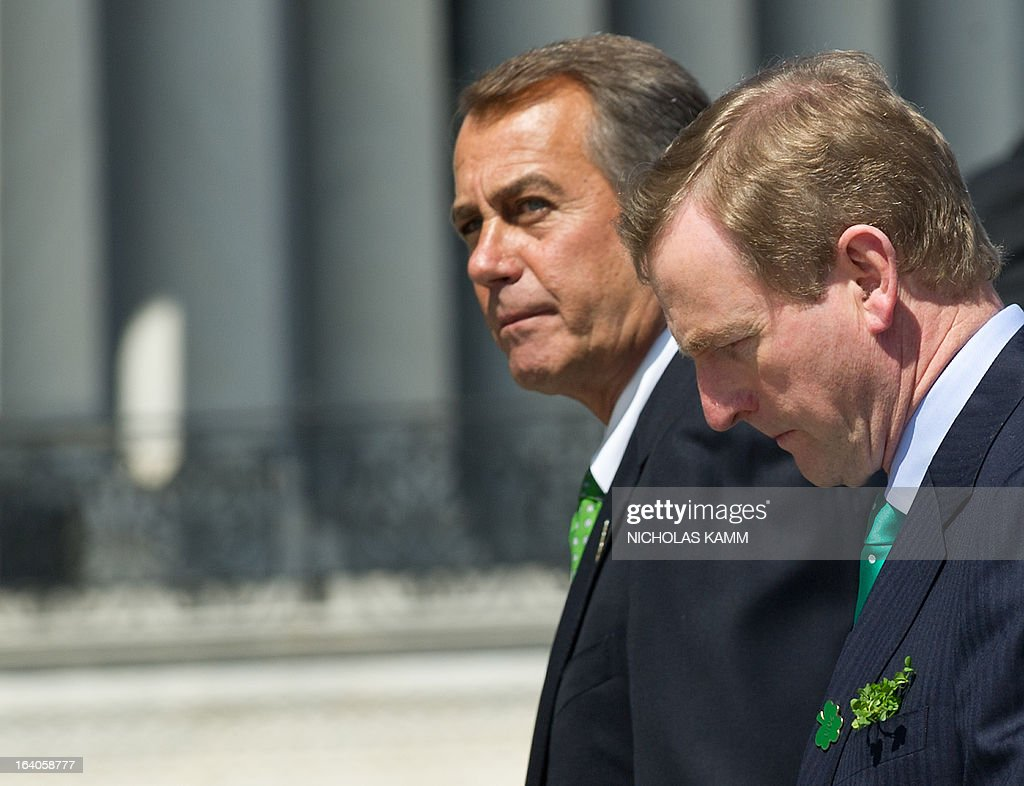 Irish Prime Minister Enda Kenny (R) and US House Speaker John Boehner walk back to the US Capitol after taking leave from US President Barack Obama after the Friends of Ireland luncheon in Washington on March 19, 2013. AFP PHOTO/Nicholas KAMM