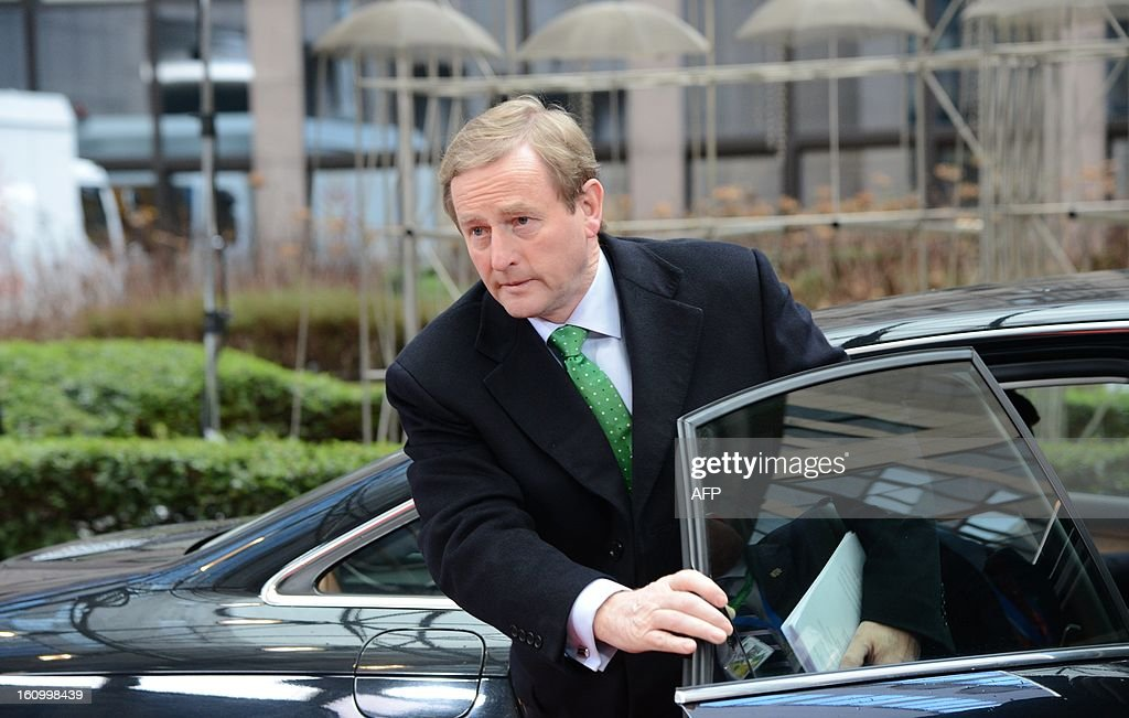 Irish Prime Minister Enda Kenny arrives at the EU Headquarters on February 8, 2013 in Brussels, on the last day of a two-day European Union leaders summit. As marathon talks entered an 18th hour EU leaders looked ready on Friday to cut the bloc's budget for the first time in its six-decade history, with a tentative agreement to trim spending by three percent in absolute terms over the rest of the decade, diplomats said. AFP PHOTO / THIERRY CHARLIER