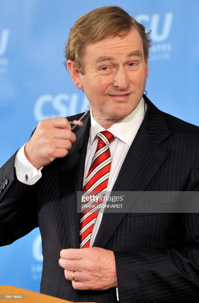 Irish Prime Minister Enda Kenny gestures as he speaks at a press conference during a convention of the Bavarian CSU party in Wildbad Kreuth, southern Germany on January 08, 2013. Kenny was invited to speak about European politics as Ireland resumed the rotating EU presidency over Cyprus. The Irish Prime Minister also commented on the current situation in Northern Ireland, saying that the situation is very serious. AFP PHOTO / FRANK LEONHARDT GERMANY OUT