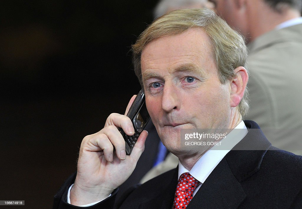 Irish Prime Minister Enda Kenny gives a phone call as he leaves the EU Headquarters, on November 23, 2012 in Brussels, after a two-day European Union leaders summit called to agree a hotly-contested trillion-euro budget through 2020. EU Council President Herman Van Rompuy said today that an EU budget deal was within reach early next year, after a two-day summit collapsed without agreement.