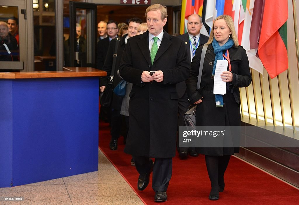 Irish Prime Minister Enda Kenny leaves the EU Headquarters on February 8, 2013 in Brussels, on the last day of a two-day European Union leaders summit. After 24 hours of talks lasting through the night, European Union leaders finally clinched a deal on the bloc's next 2014-2020 budget, summit chair and EU president Herman Van Rompuy said Friday.