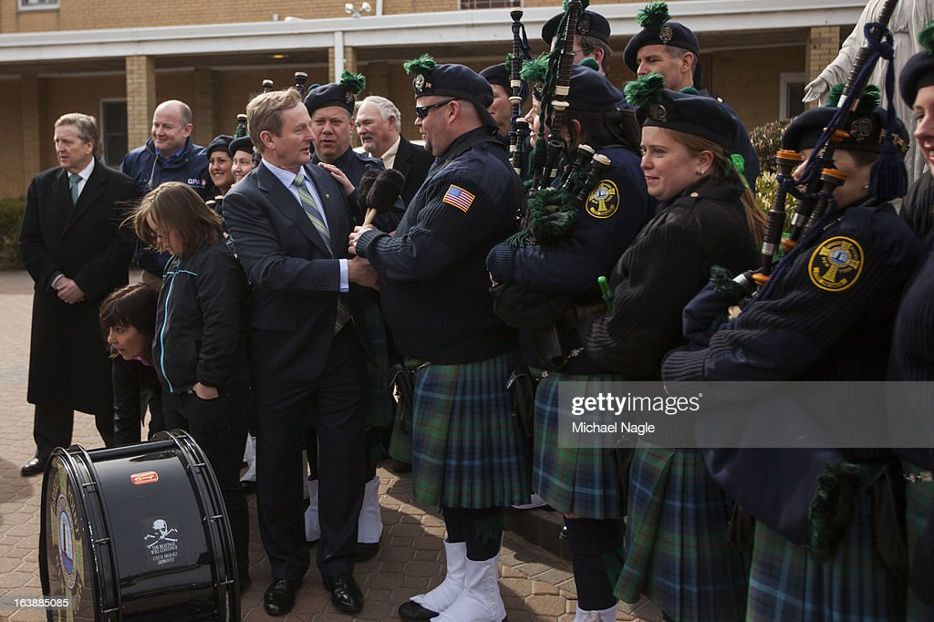 Irish Prime Minister <a gi-track='captionPersonalityLinkClicked' href=/galleries/search?phrase=Enda+Kenny&family=editorial&specificpeople=5129605 ng-click='$event.stopPropagation()'>Enda Kenny</a> (L) meets members of the Breezy Point Catholic Club Pipes & Drums after attending Saint Patrick's Day Mass at St. Thomas More Church on March 17, 2013 in the Breezy Point neighborhood in the Queens borough of New York City. Breezy Point, home to many residents with Irish ancestry, was devastated by Superstorm Sandy in October 2012.