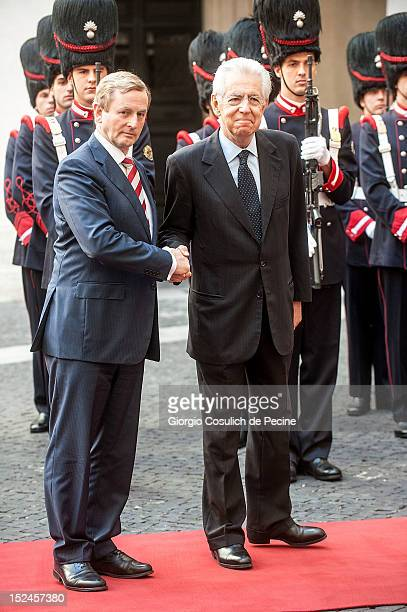 Irish Prime Minister Enda Kenny shakes hands with Italian Prime Minister Mario Monti before a meeting at Palazzo Chigi on September 21 2012 in Rome...