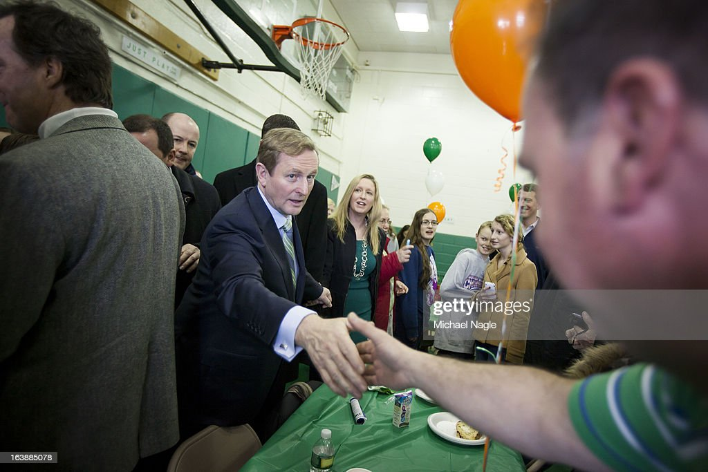 Irish Prime Minister Enda Kenny shakes hands with parishioners of St. Thomas More Church on Saint Patrick's Day, March 17, 2013 in the Breezy Point neighborhood in the Queens borough of New York City. Breezy Point, home to many residents with Irish ancestry, was devastated by Superstorm Sandy in October 2012.