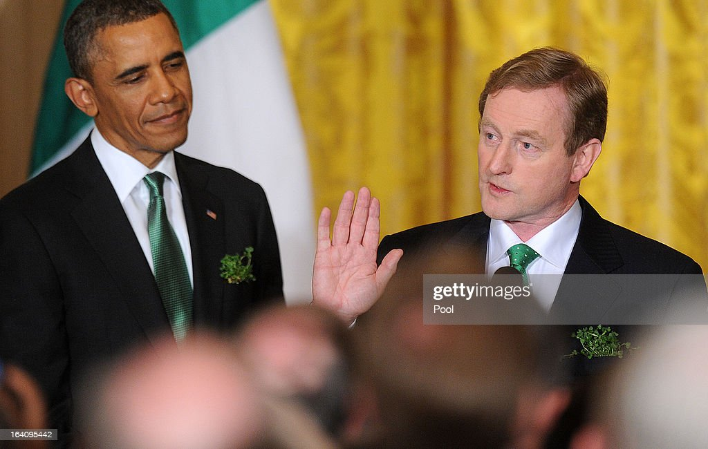 Irish Prime Minister <a gi-track='captionPersonalityLinkClicked' href=/galleries/search?phrase=Enda+Kenny&family=editorial&specificpeople=5129605 ng-click='$event.stopPropagation()'>Enda Kenny</a> (R), speaks as U.S. President <a gi-track='captionPersonalityLinkClicked' href=/galleries/search?phrase=Barack+Obama&family=editorial&specificpeople=203260 ng-click='$event.stopPropagation()'>Barack Obama</a> looks on during a reception in the East Room of the White House on March 19, 2013 in Washington, DC. President Obama met with Irish Prime Minister <a gi-track='captionPersonalityLinkClicked' href=/galleries/search?phrase=Enda+Kenny&family=editorial&specificpeople=5129605 ng-click='$event.stopPropagation()'>Enda Kenny</a> prior to the annual St. Patrick's Day lunch hosted at the Capitol.