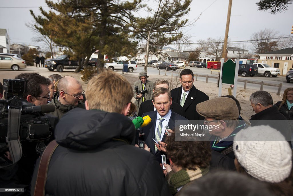 Irish Prime Minister <a gi-track='captionPersonalityLinkClicked' href=/galleries/search?phrase=Enda+Kenny&family=editorial&specificpeople=5129605 ng-click='$event.stopPropagation()'>Enda Kenny</a> (C) talks with members of the media after attending Saint Patrick's Day Mass at St. Thomas More Church on March 17, 2013 in the Breezy Point neighborhood in the Queens borough of New York City. Breezy Point, home to many residents with Irish ancestry, was devastated by Superstorm Sandy in October 2012.