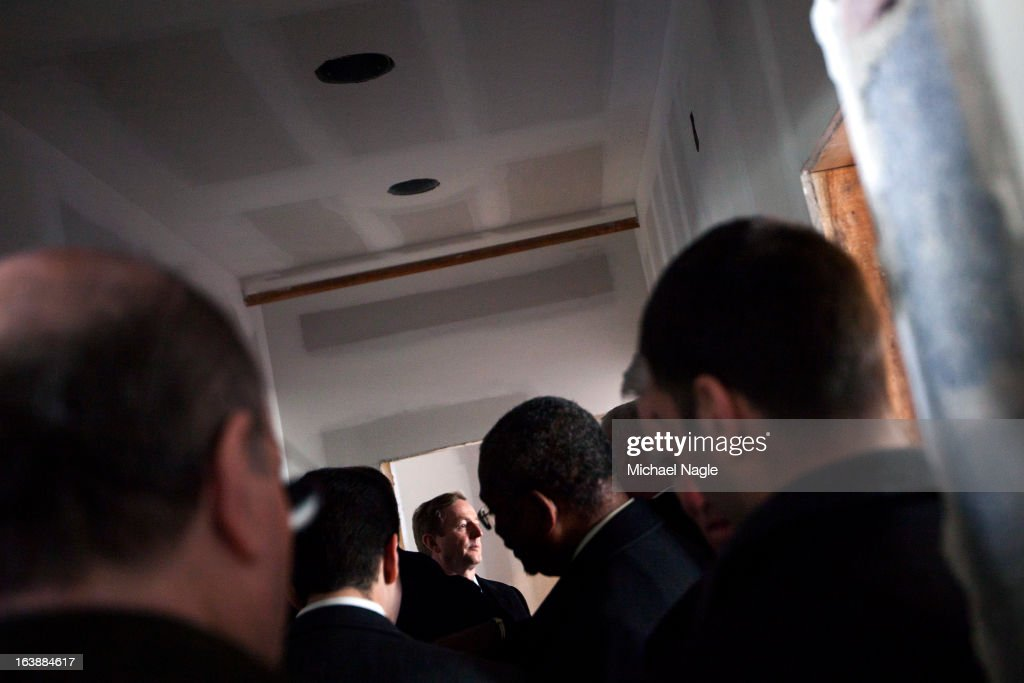Irish Prime Minister <a gi-track='captionPersonalityLinkClicked' href=/galleries/search?phrase=Enda+Kenny&family=editorial&specificpeople=5129605 ng-click='$event.stopPropagation()'>Enda Kenny</a> (C) tours the damaged Rockaway Point Volunteer Fire Department across the street from St. Thomas More Church after attending Saint Patrick's Day Mass on March 17, 2013 in the Breezy Point neighborhood in the Queens borough of New York City. Breezy Point, home to many residents with Irish ancestry, was devastated by Superstorm Sandy in October 2012.
