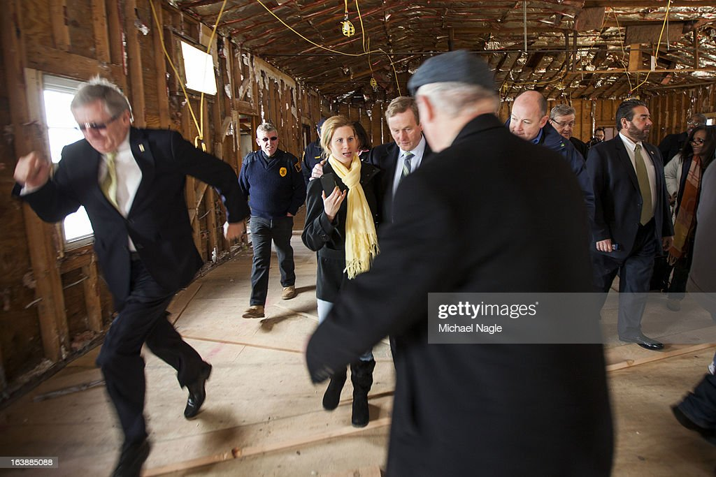 Irish Prime Minister <a gi-track='captionPersonalityLinkClicked' href=/galleries/search?phrase=Enda+Kenny&family=editorial&specificpeople=5129605 ng-click='$event.stopPropagation()'>Enda Kenny</a> (C) tours the damaged Rockaway Point Breezy Point Catholic Club across the street from St Thomas More Church after attending Saint Patrick's Day Mass on March 17, 2013 in the Breezy Point neighborhood in the Queens borough of New York City. Breezy Point, home to many residents with Irish ancestry, was devastated by Superstorm Sandy in October 2012.