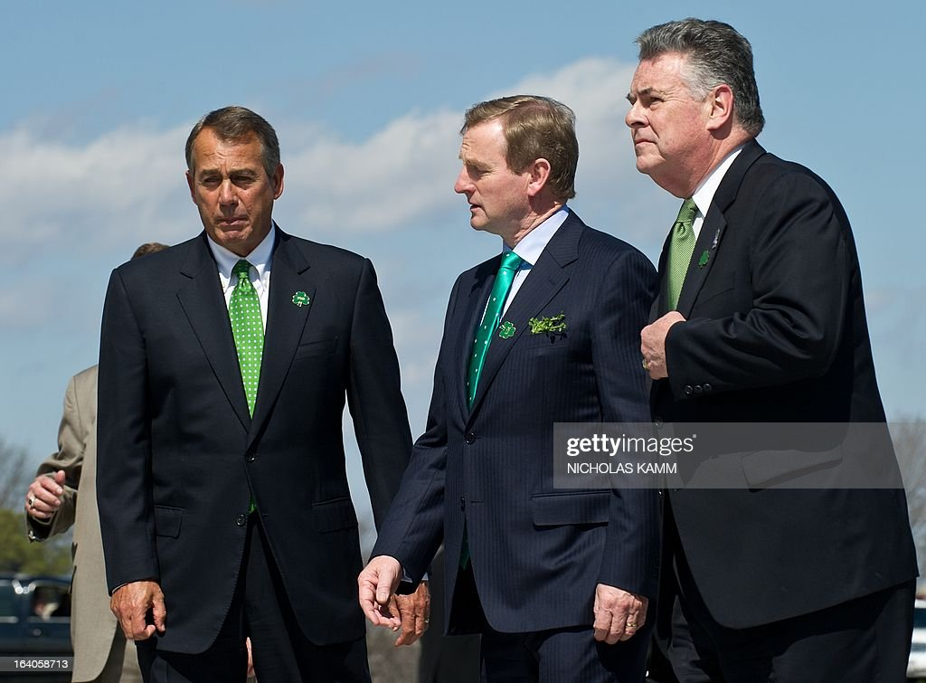 Irish Prime Minister Enda Kenny (C), US House Speaker John Boehner (L) and Rep. Peter King of New York walk back to the US Capitol after taking leave from US President Barack Obama after the Friends of Ireland luncheon in Washington on March 19, 2013. AFP PHOTO/Nicholas KAMM