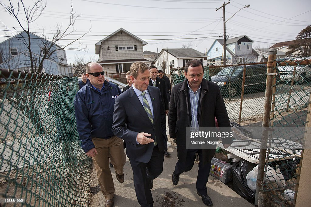 Irish Prime Minister <a gi-track='captionPersonalityLinkClicked' href=/galleries/search?phrase=Enda+Kenny&family=editorial&specificpeople=5129605 ng-click='$event.stopPropagation()'>Enda Kenny</a> (C) walks through the Breezy Point neighborhood after attending Saint Patricks Day Mass at St Thomas More Church on March 17, 2013 in the Queens borough of New York City. Breezy Point, home to many residents with Irish ancestry, was devastated by Superstorm Sandy in October 2012.
