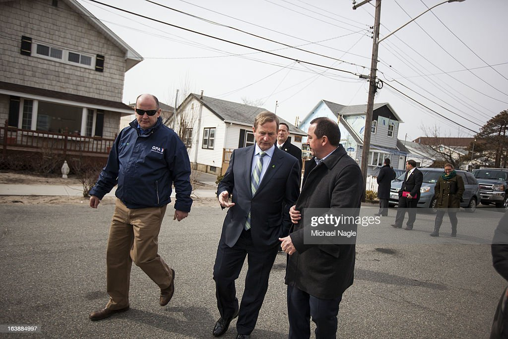 Irish Prime Minister <a gi-track='captionPersonalityLinkClicked' href=/galleries/search?phrase=Enda+Kenny&family=editorial&specificpeople=5129605 ng-click='$event.stopPropagation()'>Enda Kenny</a> (C) walks through the Breezy Point neighborhood after attending Saint Patrick's Day Mass at St. Thomas More Church on March 17, 2013 in the Queens borough of New York City. Breezy Point, home to many residents with Irish ancestry, was devastated by Superstorm Sandy in October 2012.