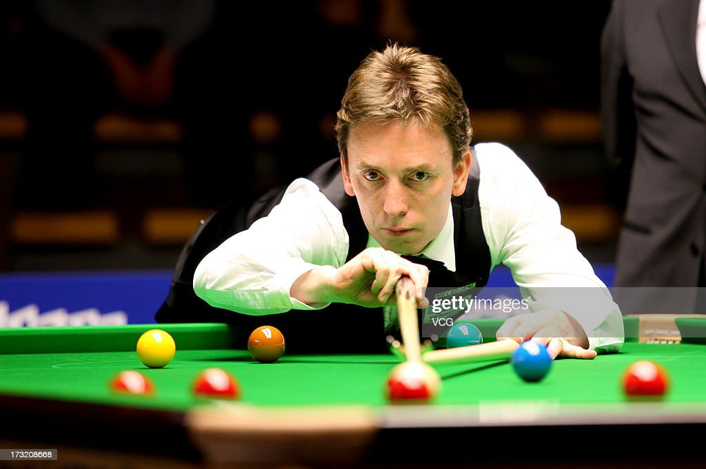Irish professional snooker player Ken Doherty plays a shot during the match against Hong Kong professional snooker player Marco Fu on day two of the World Snooker Australia Open on July 10, 2013 in Bendigo, Australia.