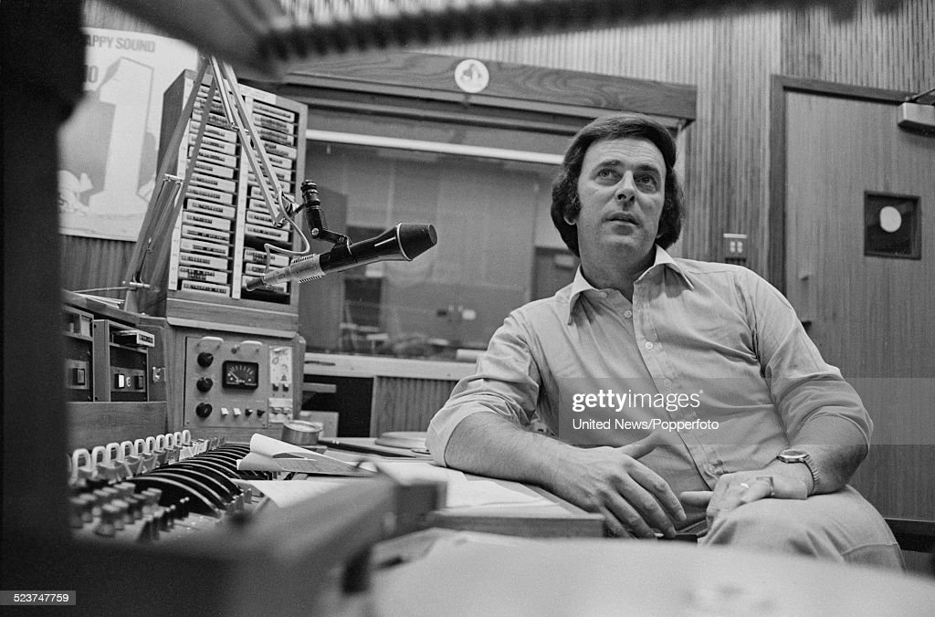 Irish radio and television broadcaster, Terry Wogan pictured sitting in a broadcasting studio at BBC Broadcasting House in London on 2nd October 1978.