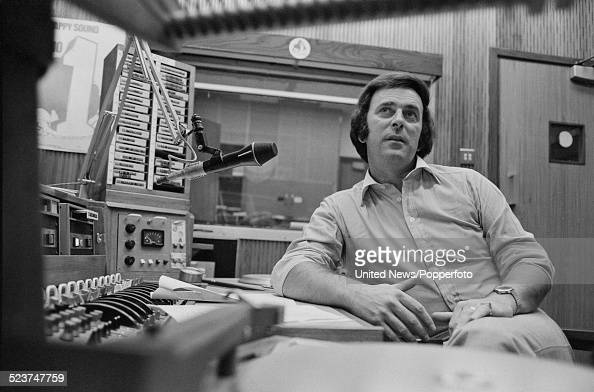 Irish radio and television broadcaster Terry Wogan pictured sitting in a broadcasting studio at BBC Broadcasting House in London on 2nd October 1978