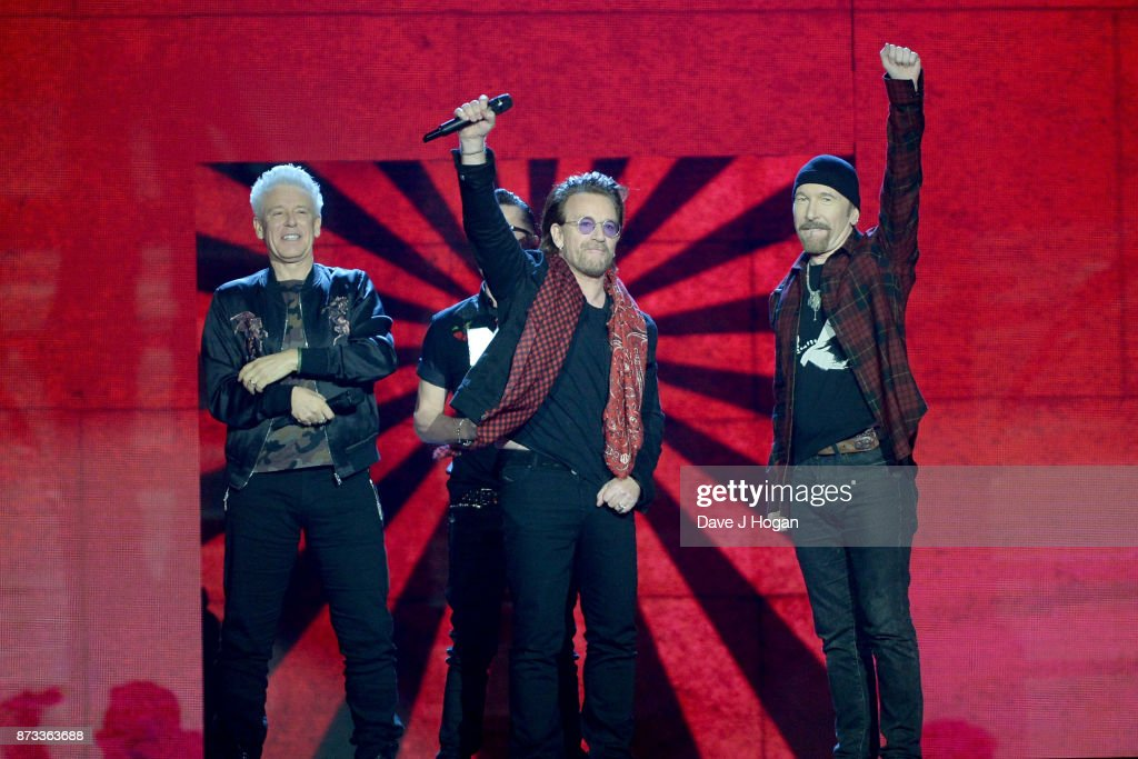 Irish rock band U2, Bono (2R), The Edge (R), Adam Clayton (L) and Larry Mullen Jr (2L), accept the global icon award on stage during the MTV EMAs 2017 held at The SSE Arena, Wembley on November 12, 2017 in London, England.