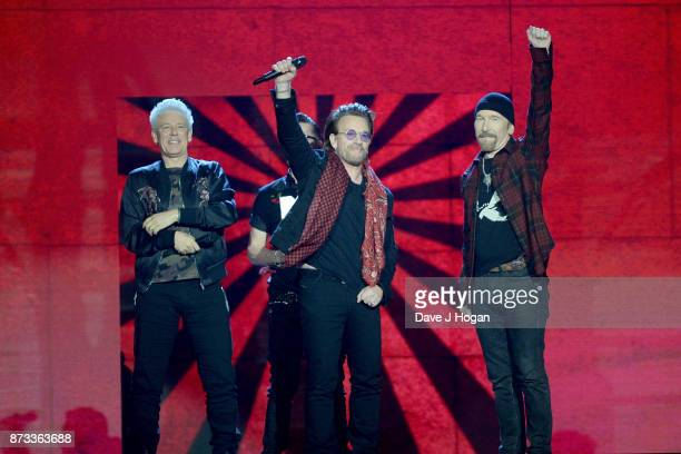 Irish rock band U2 Bono The Edge Adam Clayton and Larry Mullen Jr accept the global icon award on stage during the MTV EMAs 2017 held at The SSE...