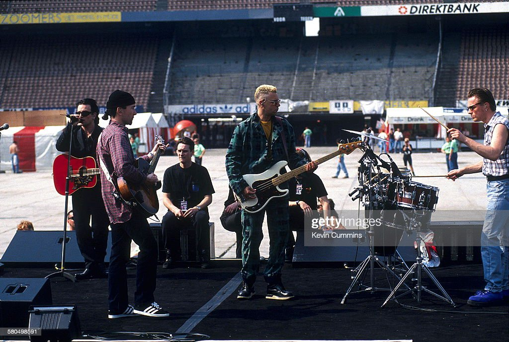 Irish rock group U2 at a soundcheck circa 1992 Standing left to right singer Bono guitarist The Edge bassist Adam Clayton and drummer Larry Mullen