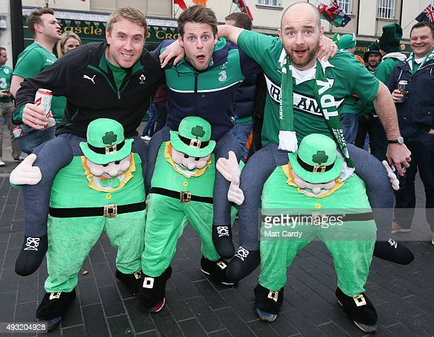 Irish rugby fans pose for a photograph close to the Millennium Stadium where Ireland are playing Argentina in the quarter finals of the Rugby World...