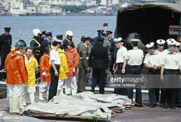 Irish sailors unload on June 29 1985 at a navy base in Cork bodies from the Air India Flight 182 that crashed off the coast of Ireland on June 23 The...