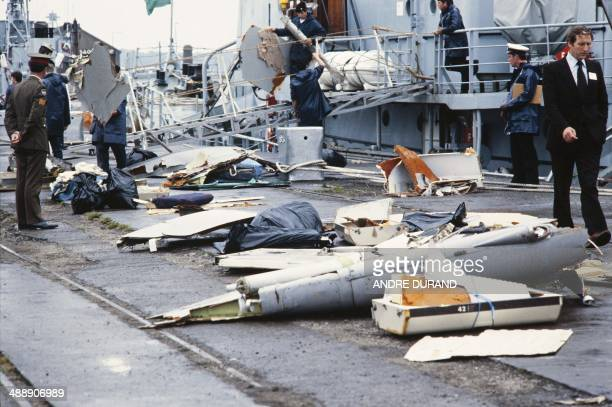Irish sailors unload on June 29 1985 at a navy base in Cork debris from the Air India Flight 182 that crashed off the coast of Ireland on June 23 The...