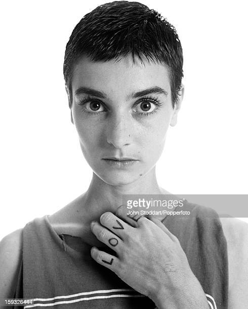 Irish singer and songwriter Sinéad O'Connor with the word 'love' written on her fingers 1994