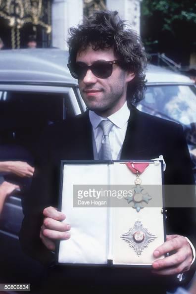 Irish singer Bob Geldof receives a knighthood for his charity work 1986