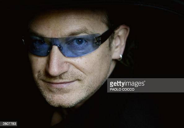 Irish singer Bono lead singer of the rock group U2 peers out from a car's window after attending the wedding of famous tenor Luciano Pavarotti and...