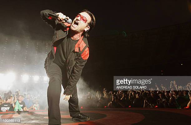 Irish singer Bono of the band U2 performs during a concert at the Olympic Stadium in Rome 23 July 2005 The band is in Italy as part of their 'Vertigo...