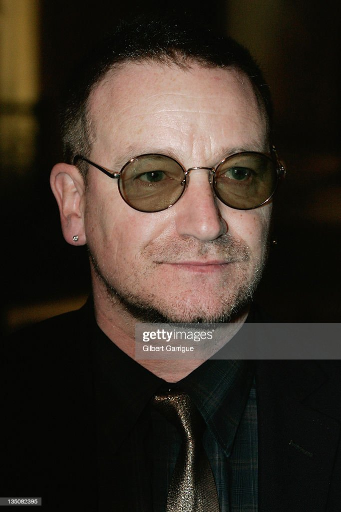 Irish Singer <a gi-track='captionPersonalityLinkClicked' href=/galleries/search?phrase=Bono&family=editorial&specificpeople=167279 ng-click='$event.stopPropagation()'>Bono</a> of <a gi-track='captionPersonalityLinkClicked' href=/galleries/search?phrase=U2&family=editorial&specificpeople=201268 ng-click='$event.stopPropagation()'>U2</a> talks to journalists as he leaves Elysee Palace after a meeting with French President <a gi-track='captionPersonalityLinkClicked' href=/galleries/search?phrase=Nicolas+Sarkozy&family=editorial&specificpeople=211375 ng-click='$event.stopPropagation()'>Nicolas Sarkozy</a> on January 8, 2008 in Paris, France.