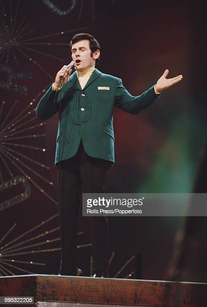 Irish singer Pat McGuigan performs the song 'Chance of a lifetime' on stage for Ireland in the Eurovision Song Contest at the Royal Albert Hall in...