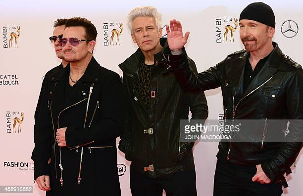 Irish singersongwriter Bono and his band U2 pose as they arrive for the Bambi awards on November 13 2014 in Berlin The Bambis are the main German...