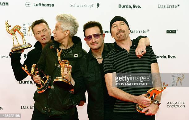 Irish singersongwriter Bono and members of his band U2 pose with their trophies they were given in the category 'Music International' during the...