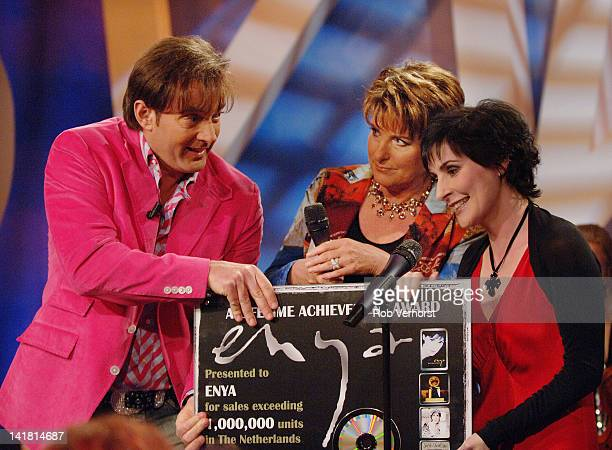 Irish singersongwriter Enya receives an award from Dutch TV presenters Gerard Joling and Catherina Keyl on the TV show Program MAX Hilversum...