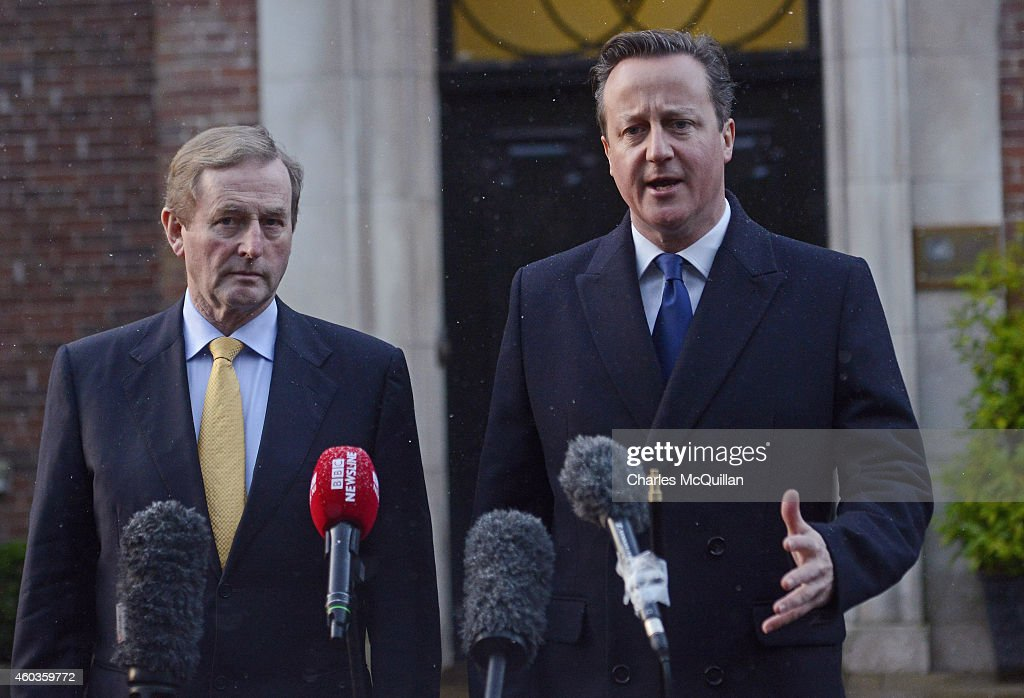 Irish Taoiseach Enda Kenny and Prime Minister David Cameron address the media before departing the cross party talks at Stormont on December 12, 2014 in Belfast, Northern Ireland. British Prime Minister Cameron left talks in Northern Ireland stating that unless they can reach an agreement on outstanding disputes the 1 billion GBP financial package will not be offered to them.