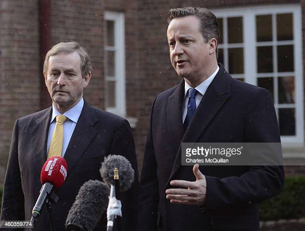 Irish Taoiseach Enda Kenny and Prime Minister David Cameron address the media before departing the cross party talks at Stormont on December 12 2014...